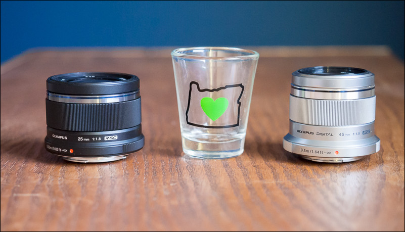Olympus makes amazing prime lenses that are so small they can get lost in your camera bag.