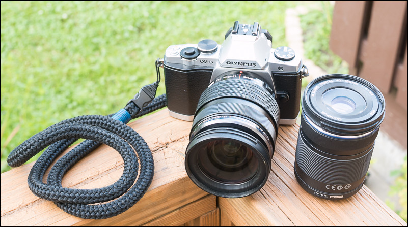 The Olympus OM-D E-M5 with the 12-40mm f/2.8 Pro attached and 40-150mm f/4-f/5.6 beside.
