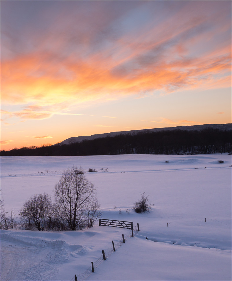 I love the colors captured in this winter sunset taken at f/5 at 15mm and 1/100 sec at ISO 100